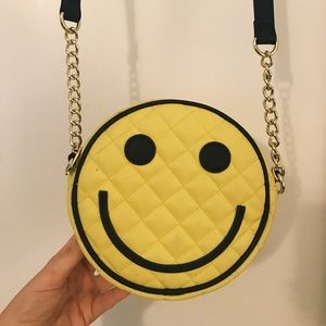 Betsey Johnson smiley face purse.